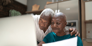 Image of an elderly couple on the computer